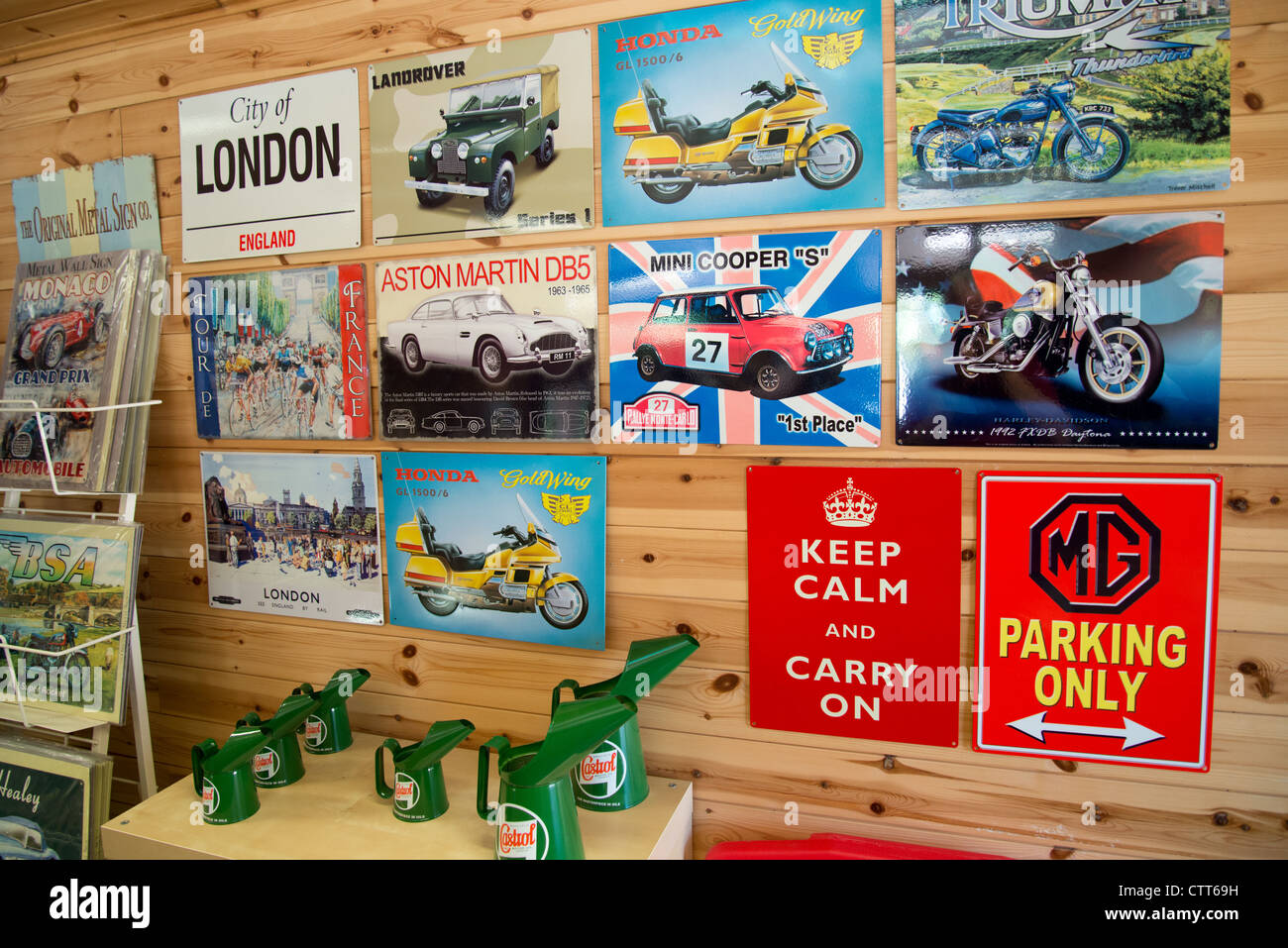 Reproduction, motoring advertising signs in shop at