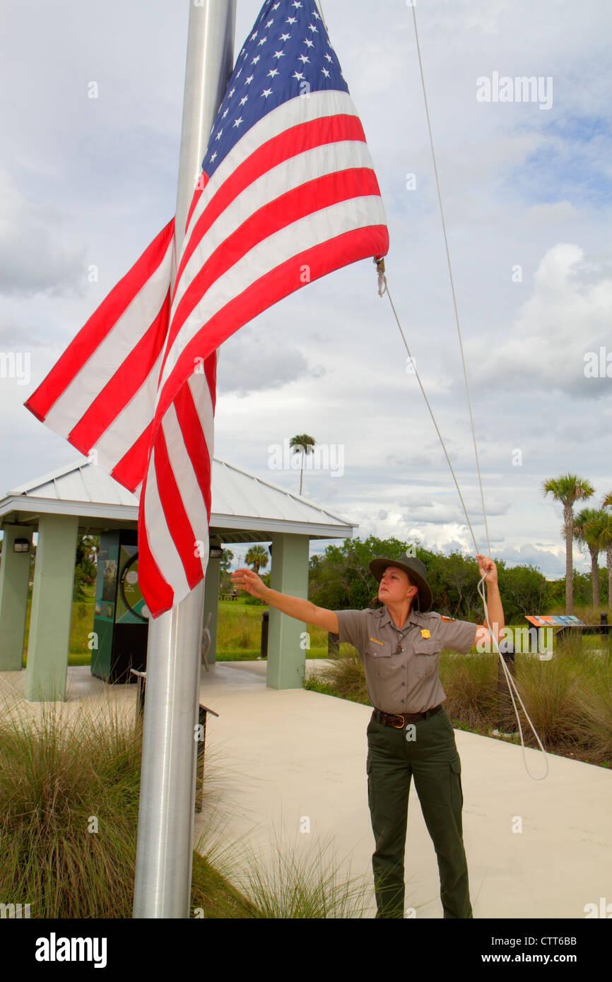 Naples Everglades Florida Big Cypress National Preserve Big Cypress Swamp Welcome Center park ranger flagpole flag Stock Photo