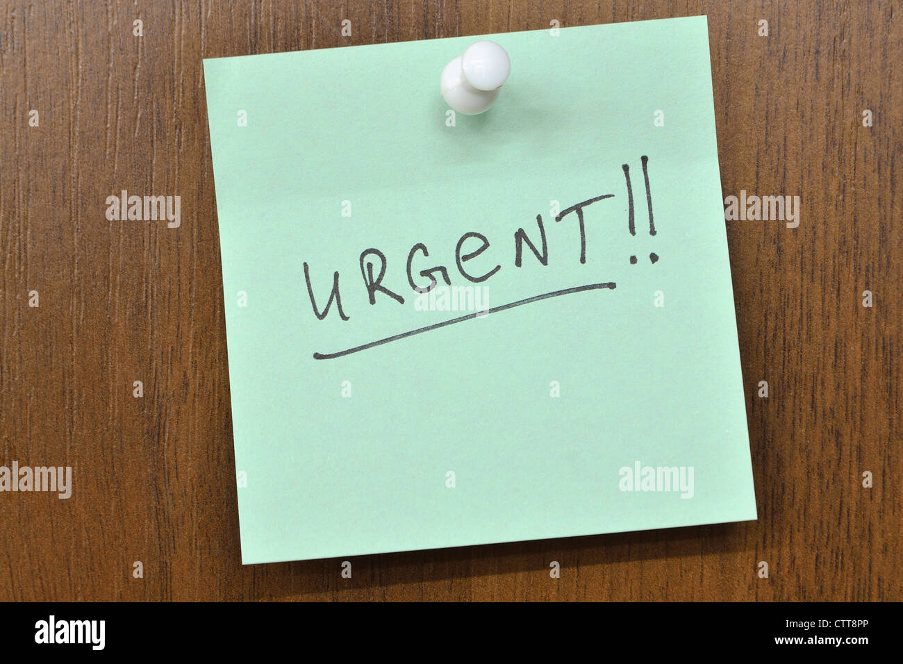 post it note with urgent! word Stock Photo