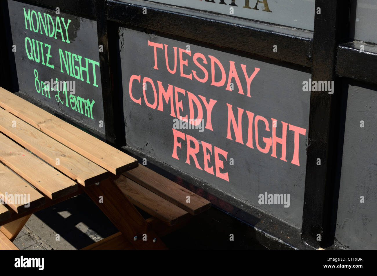 A board outside a pub promoting a comedy night and quiz night, London, UK Stock Photo