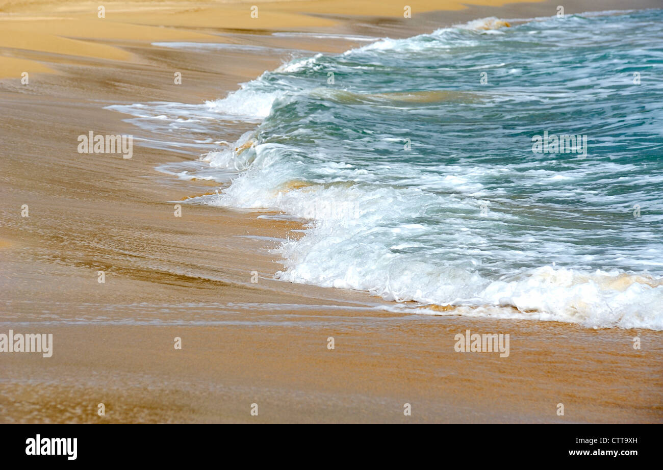 waves lapping up on the beach menorca spain - Stock Image