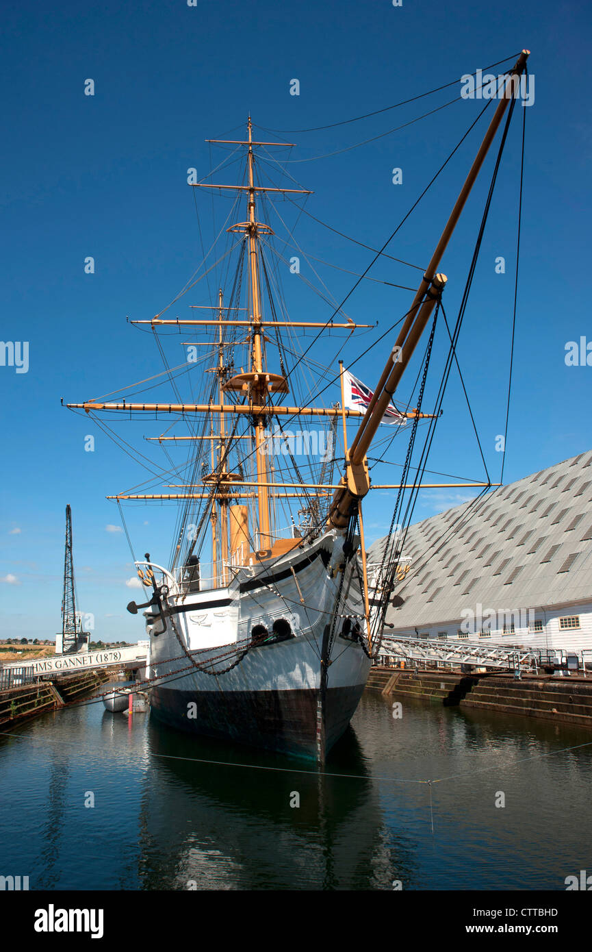 HMS GANNET. Historic ironclad Victorian sailing sloop at Chatham historic dockyard, Kent, England.  Blue cloudless - Stock Image