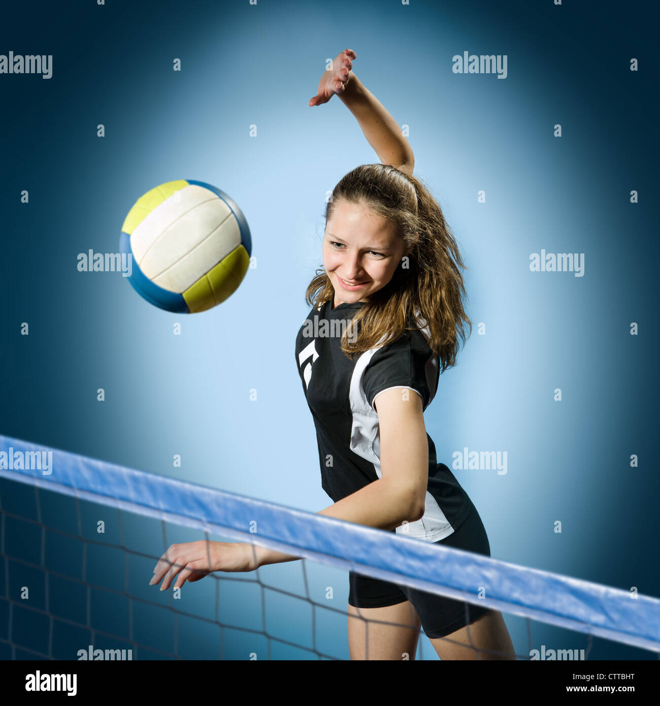 female volleyball player with a ball - Stock Image