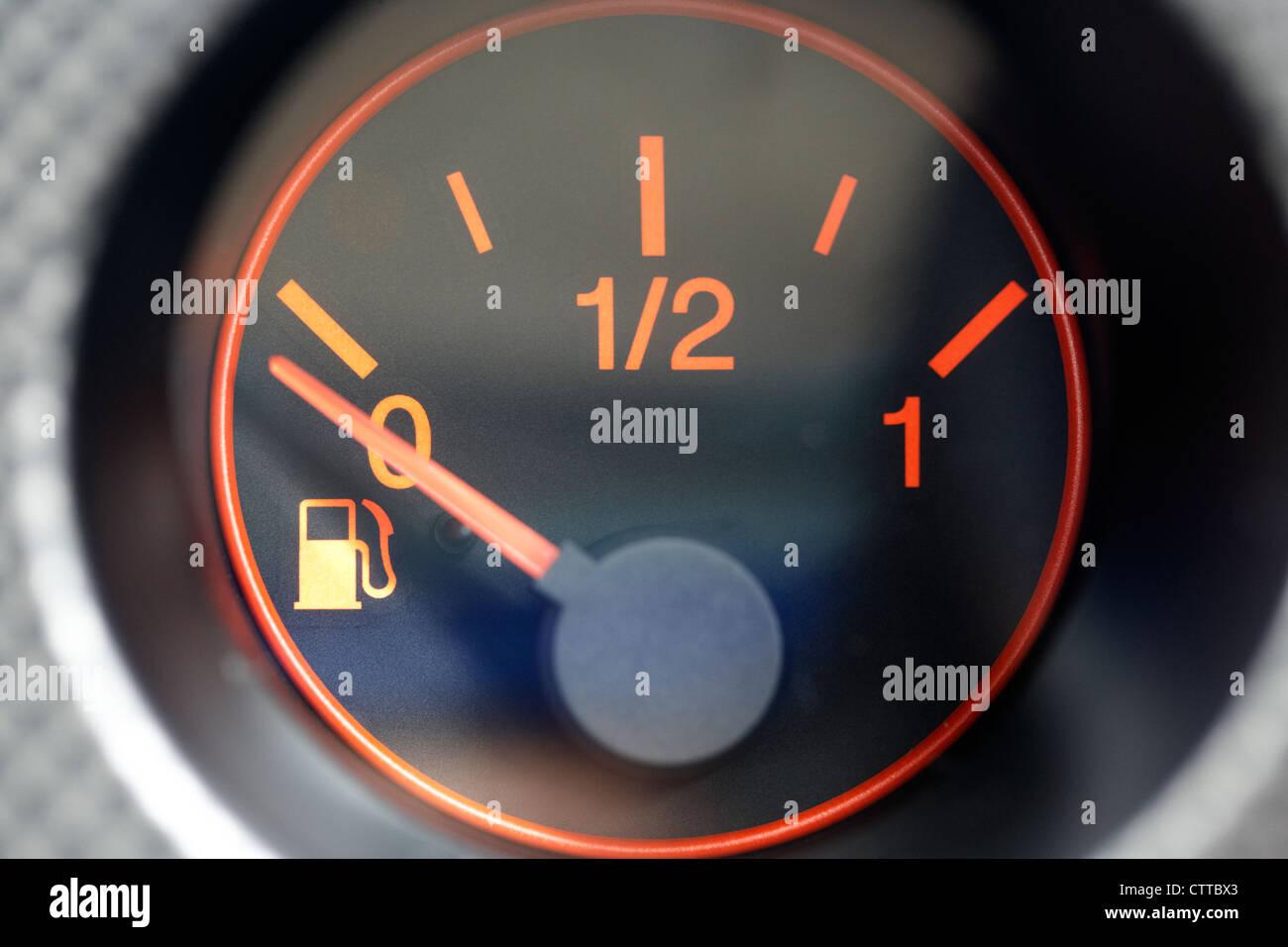 car vehicle fuel gauge showing empty - Stock Image
