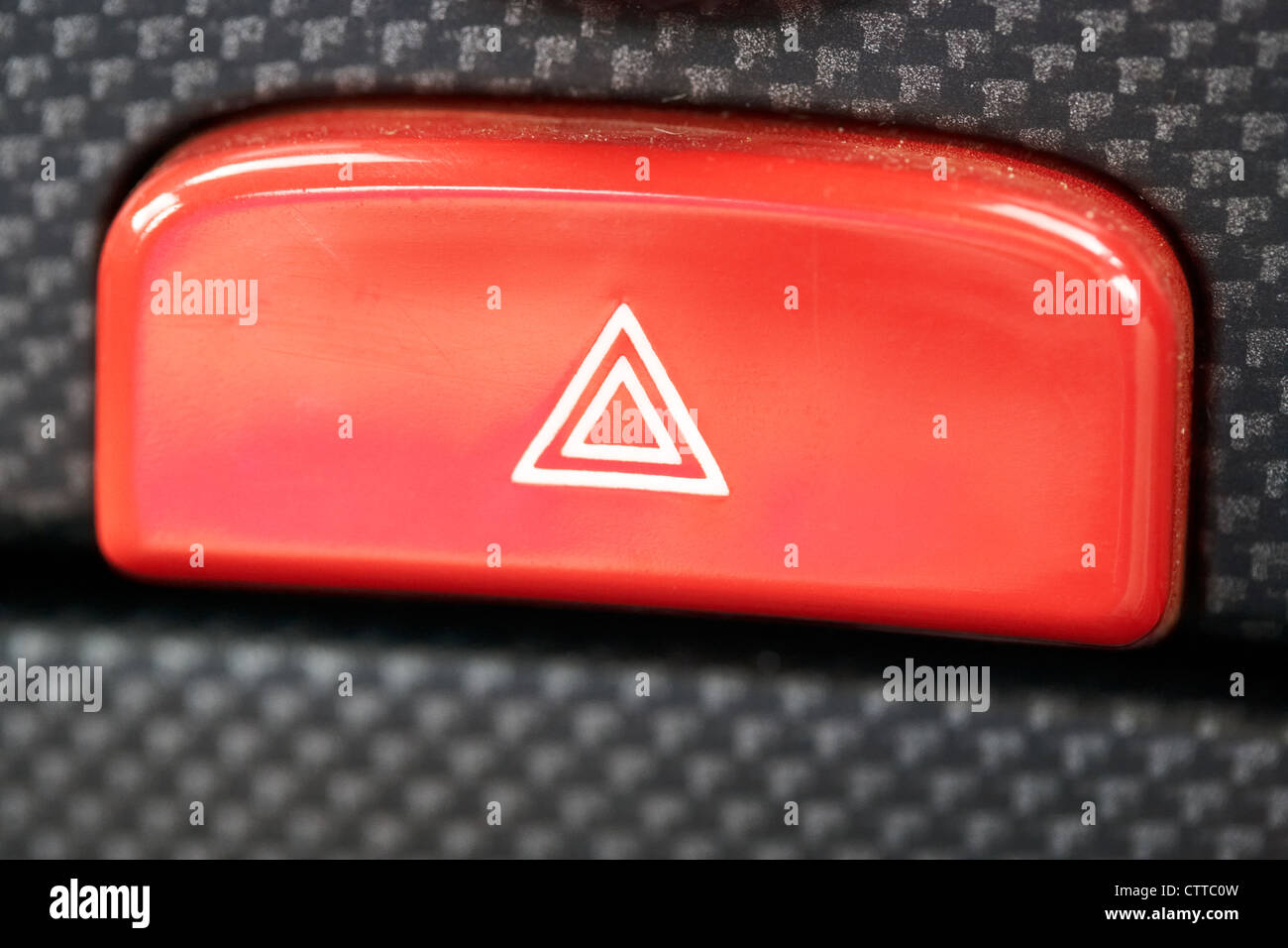 in car hazard warning light button - Stock Image