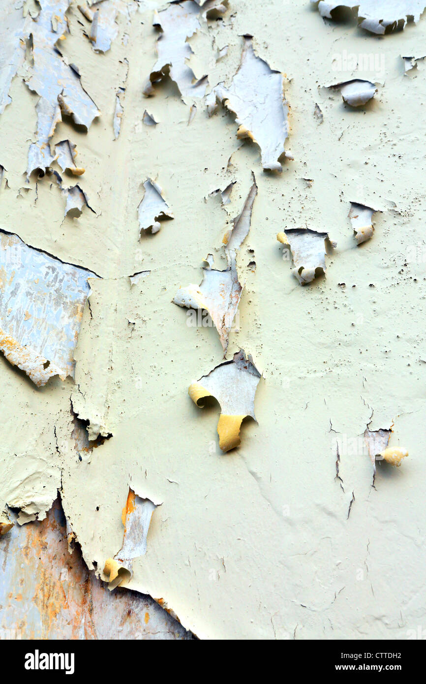 Flaking paint on building background. - Stock Image