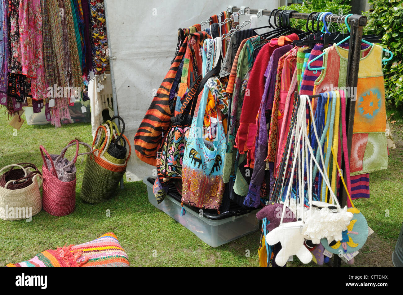 Colourful Fair Trade clothes bags and scarfs for sale at a country  fair Ceredigion Wales Cymru UK GB - Stock Image