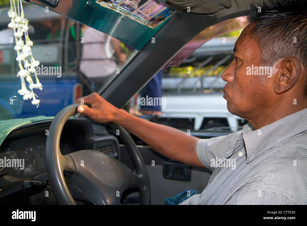 Burmese taxi driver in (Rangoon) Yangon, (Burma) Myanmar. - Stock Image