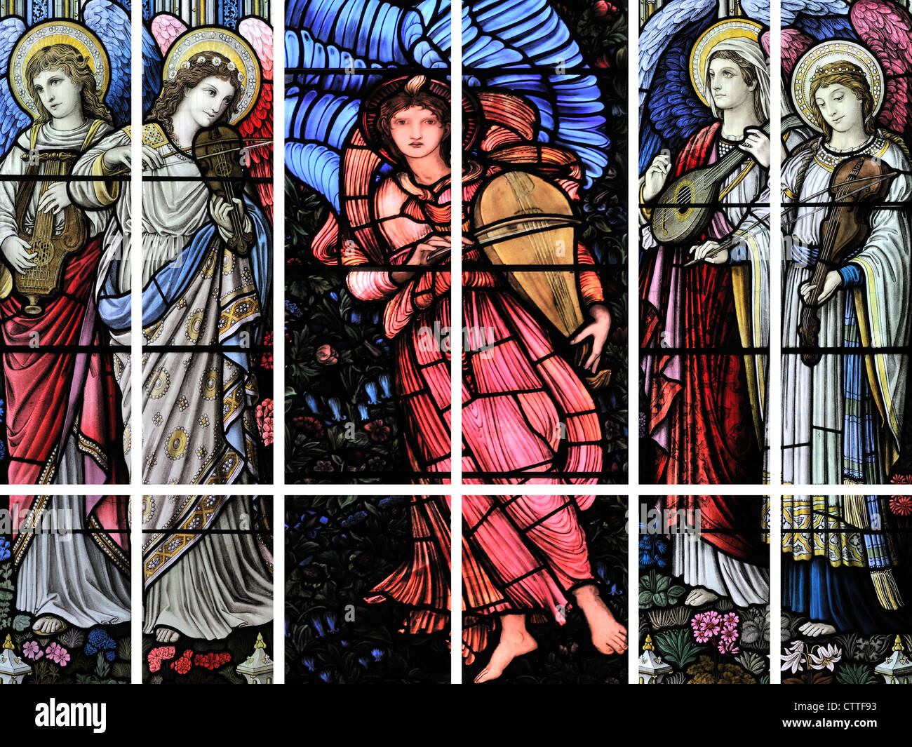 A polyptych depicting five winged-angels playing stringed instruments - Stock Image