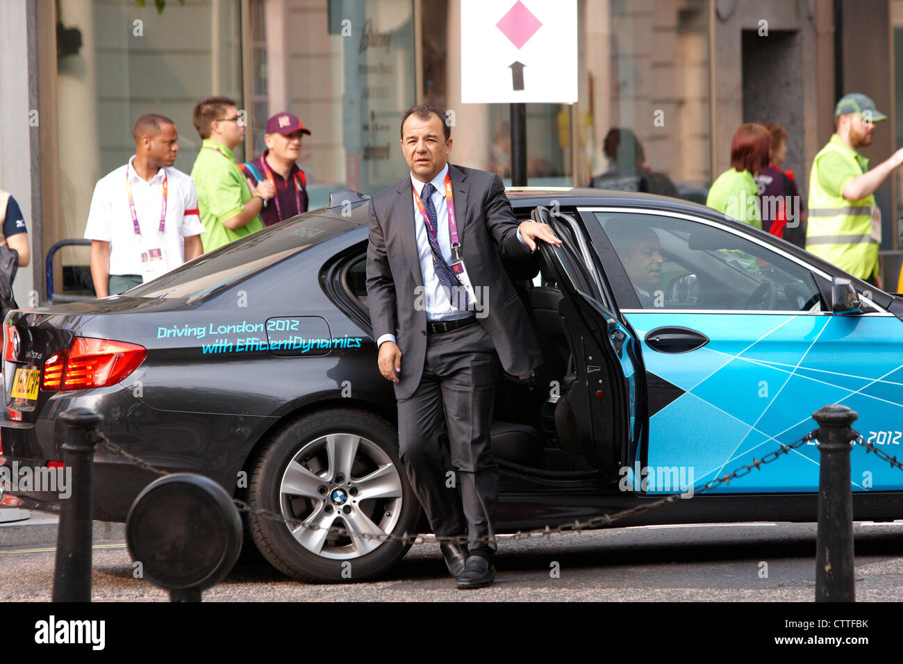 IOC Olympic delegate exits an offical games car outside the Hilton Hotel, Park Lane, London. - Stock Image
