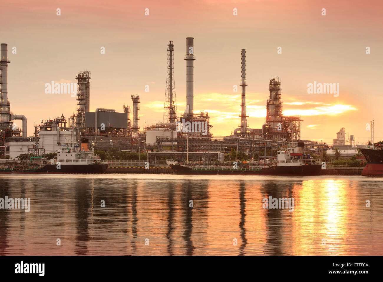 Landscape of river and oil refinery factory between sun rise time in Chao praya river, Bangkok, Thailand. - Stock Image