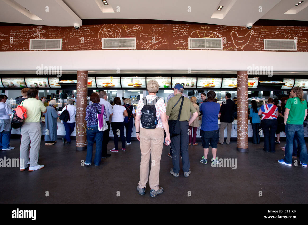 Customers buying food in McDonald's in Olympic Park, London - Stock Image