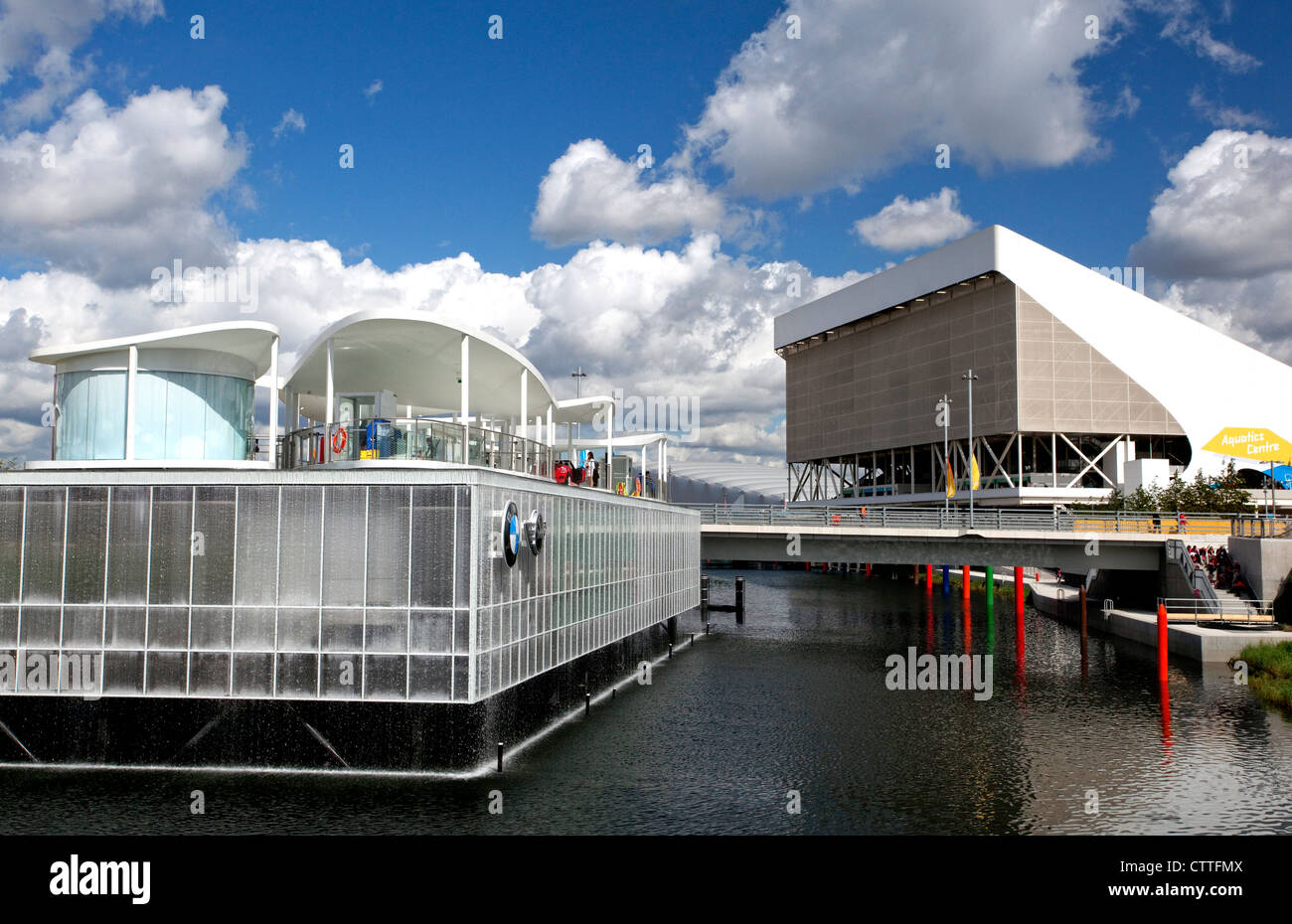 Aquatics Centre (left) and BMW Mini pavilion (right) in Olympic Park, London - Stock Image