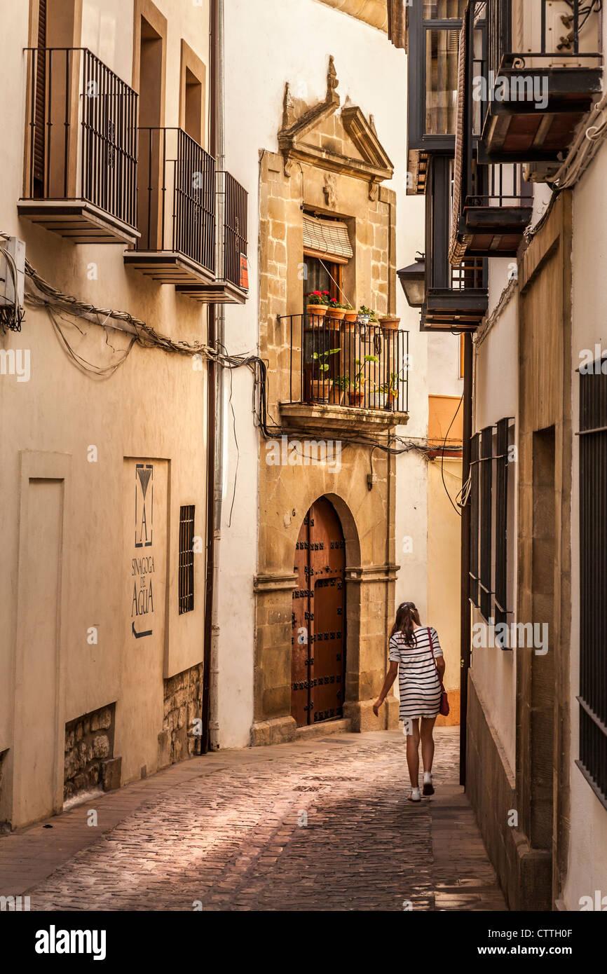 Street scene, woman walking down street in Úbeda, Jaén, Andalusia, Spain. Europe. - Stock Image