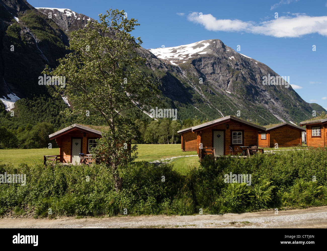 Hoiday cabins with turf roofs at Trollstigen Romsdal Norway - Stock Image