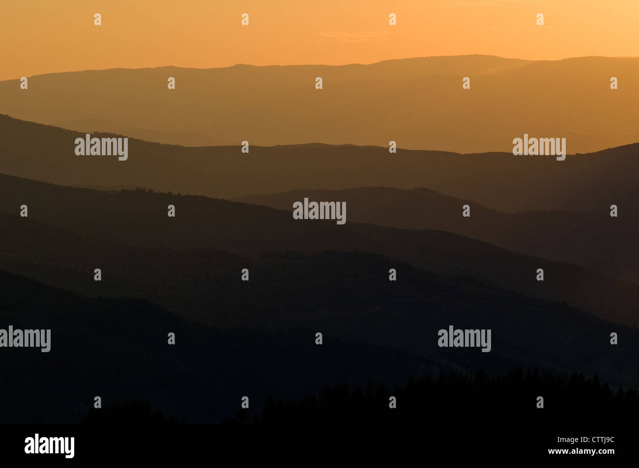 hazy layered sunset from the top of Vail Mountain, Vail Colorado, USA, late summer - Stock Image