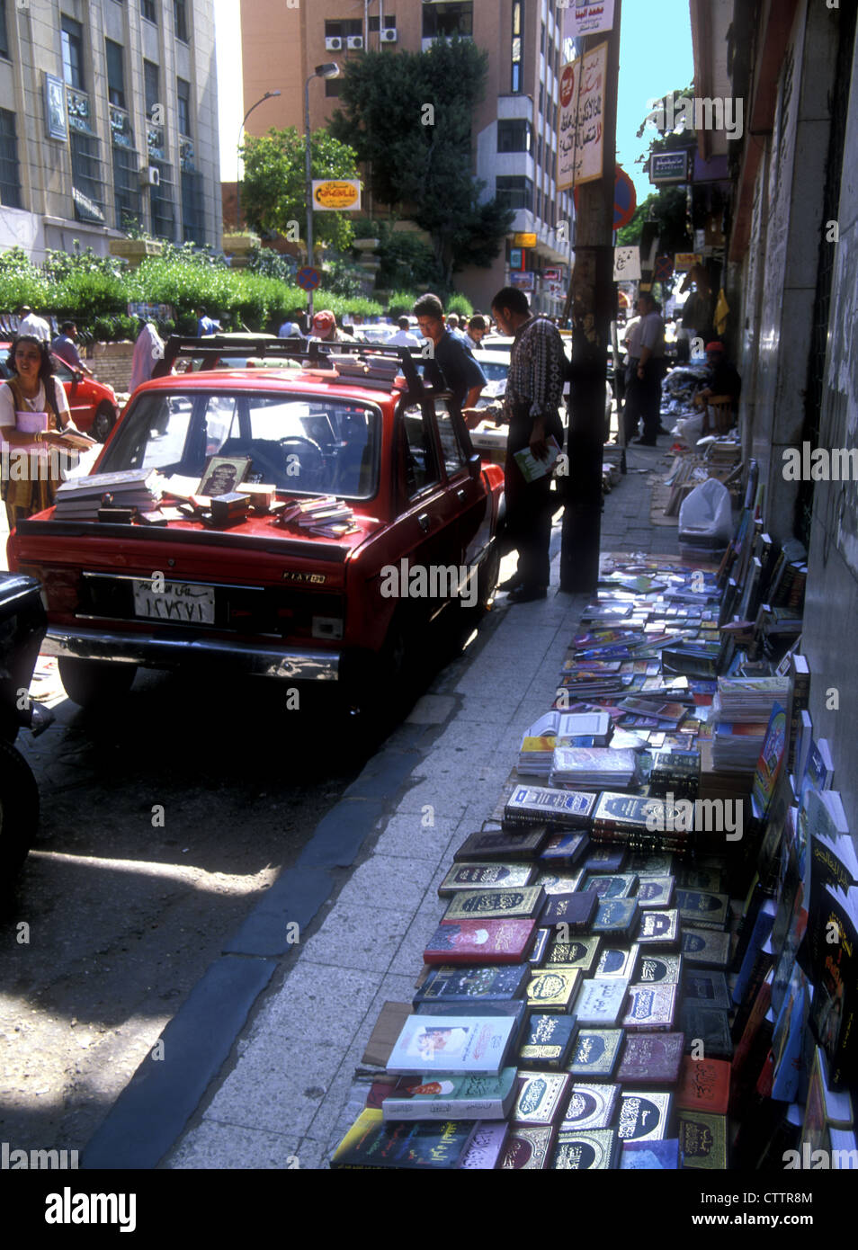 Street book-seller in Alexandria with copies of the Holy Koran, Egypt - Stock Image