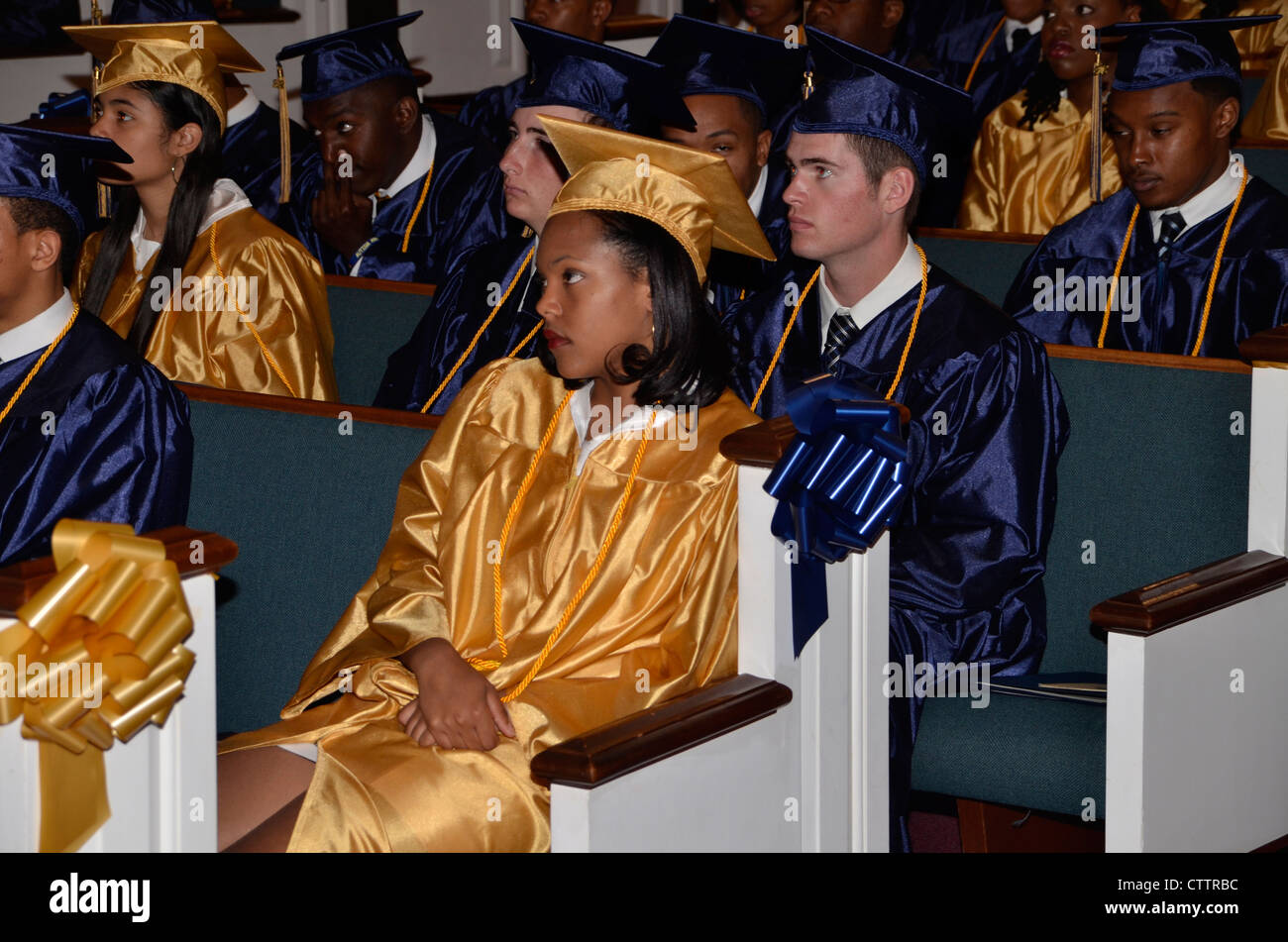 High school graduates  listen to speakers at their high school graduation in Forestville, Maryland - Stock Image