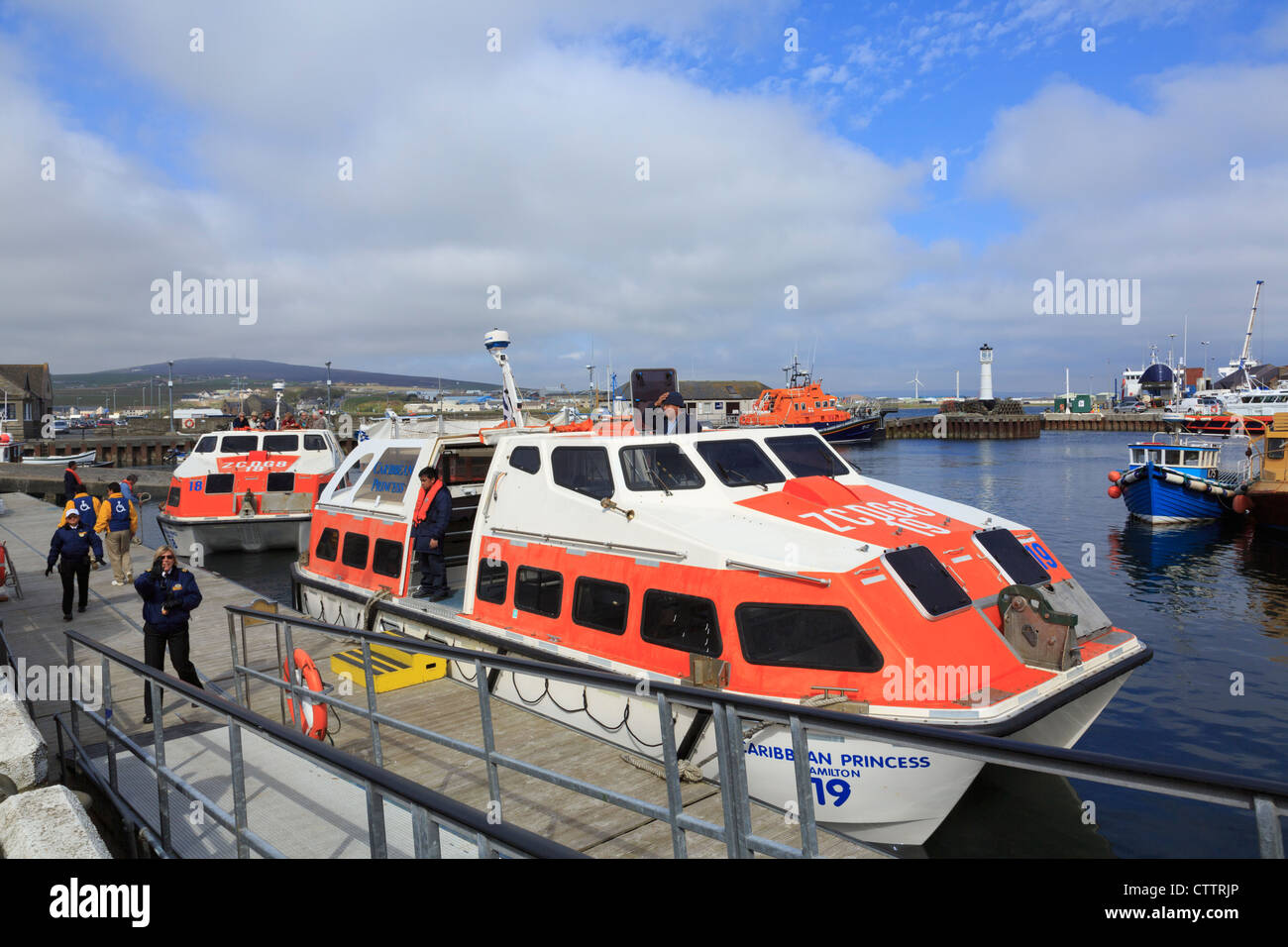 Landing craft arriving in harbour from Caribbean Princess cruise ship visiting Kirkwall, Orkney Mainland, Scotland, - Stock Image