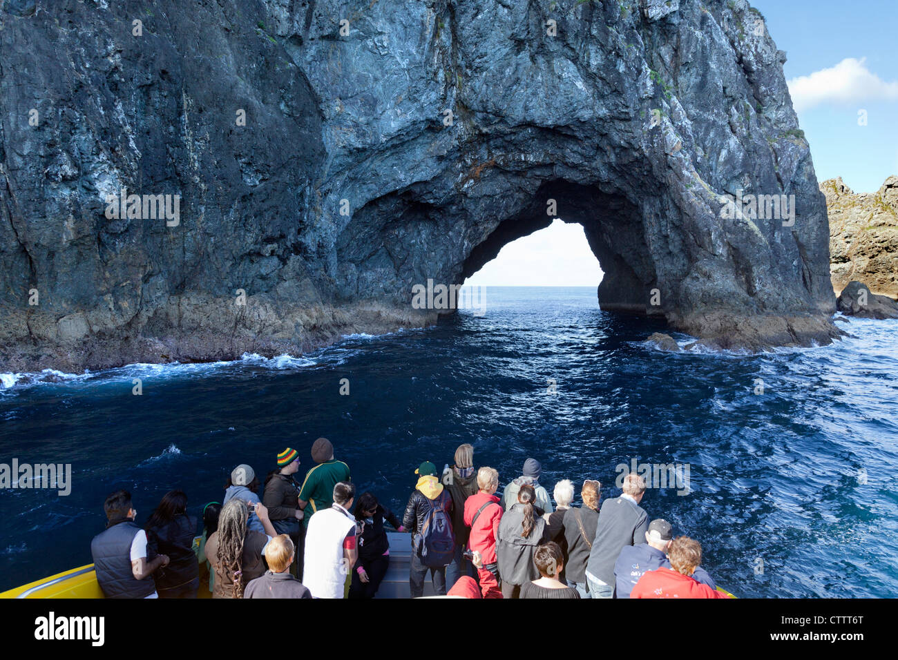 Cruising the Bay of Islands, New Zealand - photographing the Hole in the Rock - Stock Image