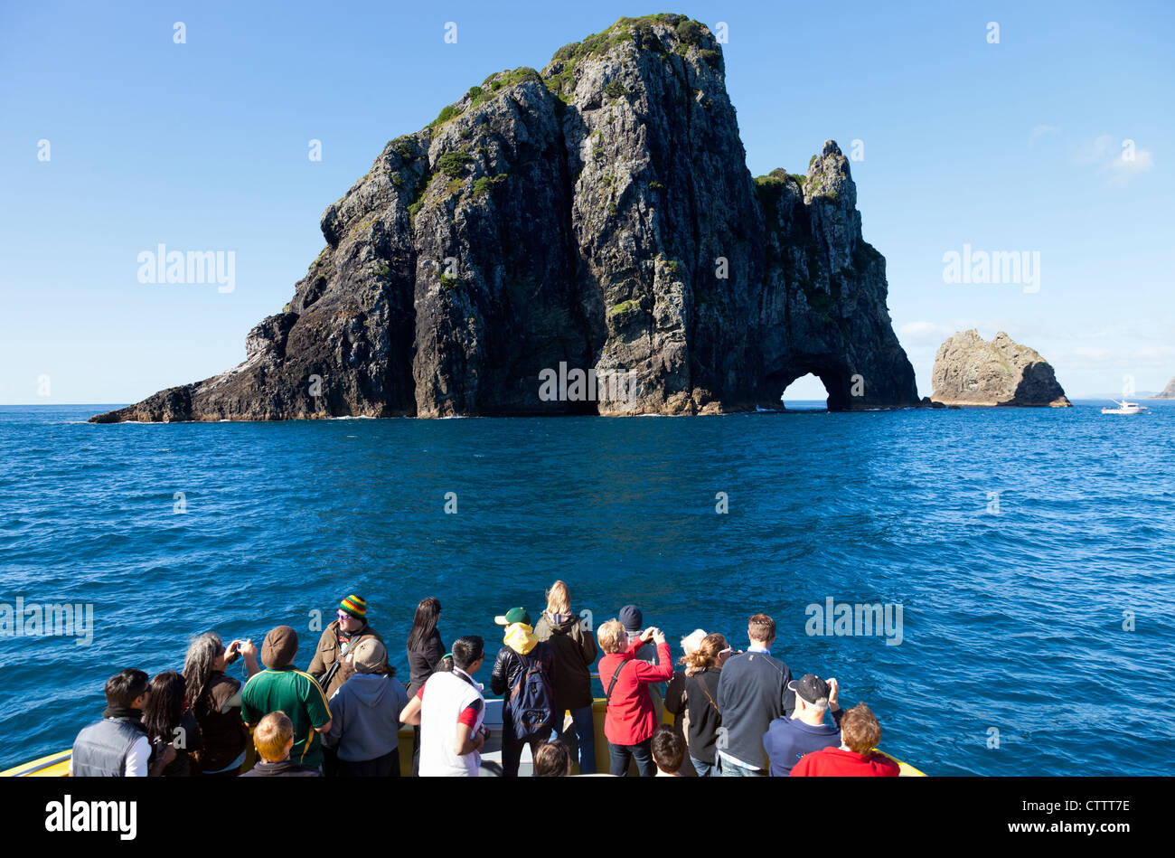 Cruising the Bay of Islands, New Zealand - photographing the Hole in the Rock 2 - Stock Image