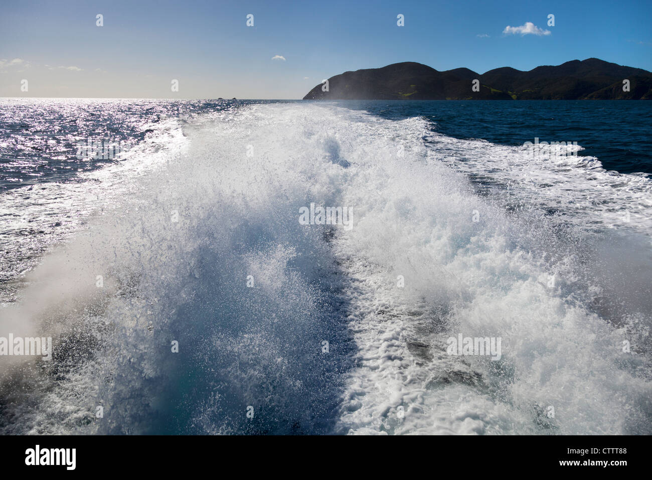Cruising the Bay of Islands, New Zealand - wake behind our boat - Stock Image