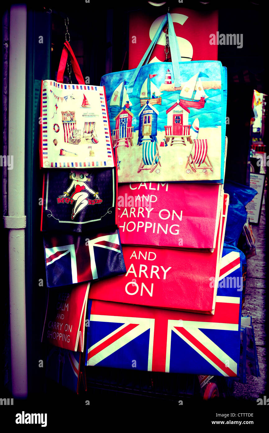 Instagram style image of Carry On and British patriotic carry bags on sale outside a store - Stock Image
