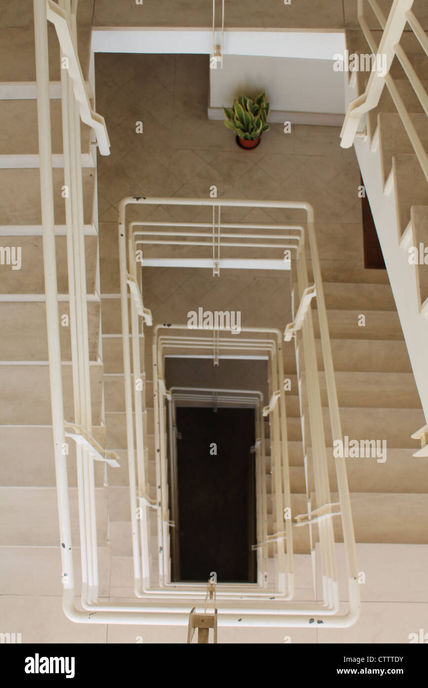 View from the top of a multiple staircase looking down - Stock Image