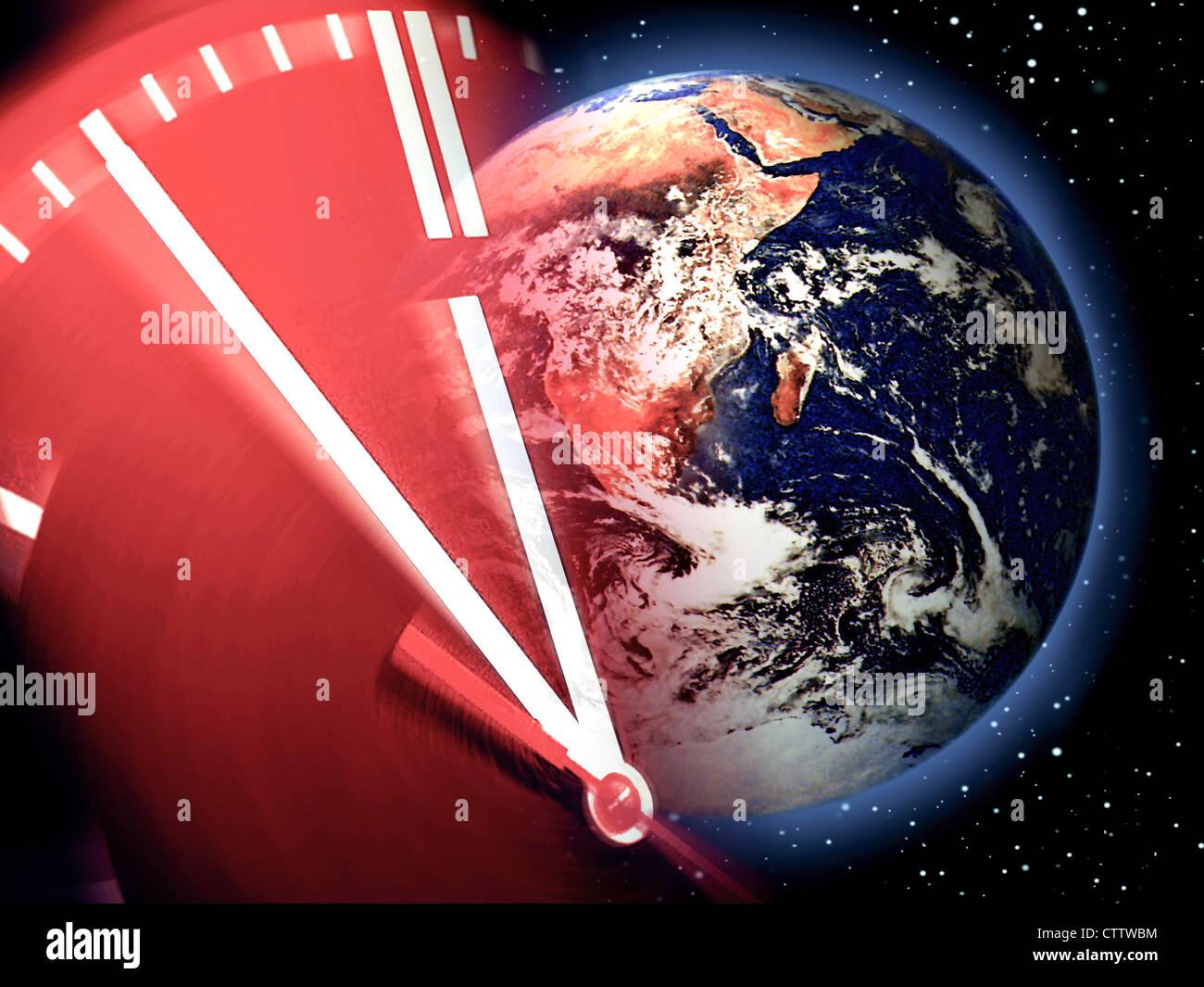 Weltkugel und Uhr kurz vor 12 Stock Photo