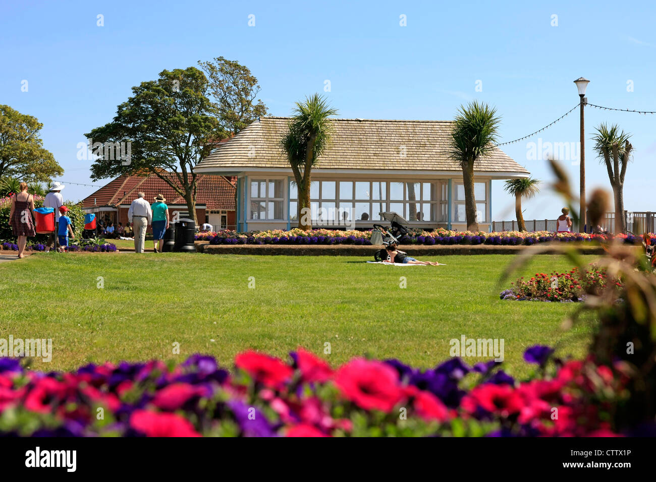 Exmouth Esplanade Gardens with it's 1930s windbreak shelters - Stock Image