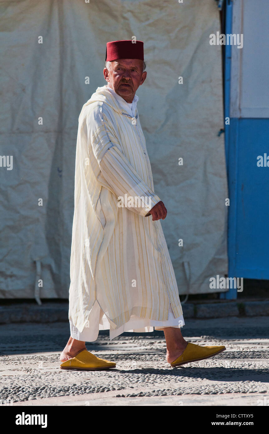 Man In A Traditional Fez And Djellaba In Fes Morocco