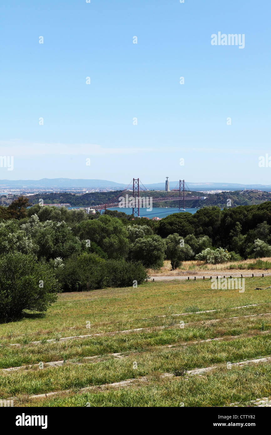 The Christus Rei statue and April 25 Bridge, seen from Monsanto in Lisbon, Portugal. - Stock Image