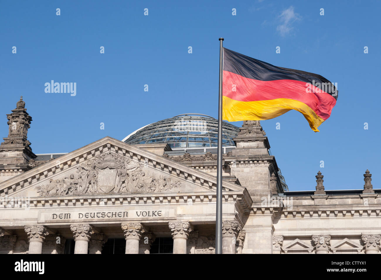 German Flag in front of Reichstag Berlin Germany - Stock Image
