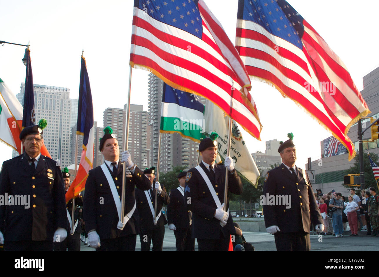 The NYPD Emerald Society color guard marches during the one year anniversary observance of the September 11th attacks - Stock Image
