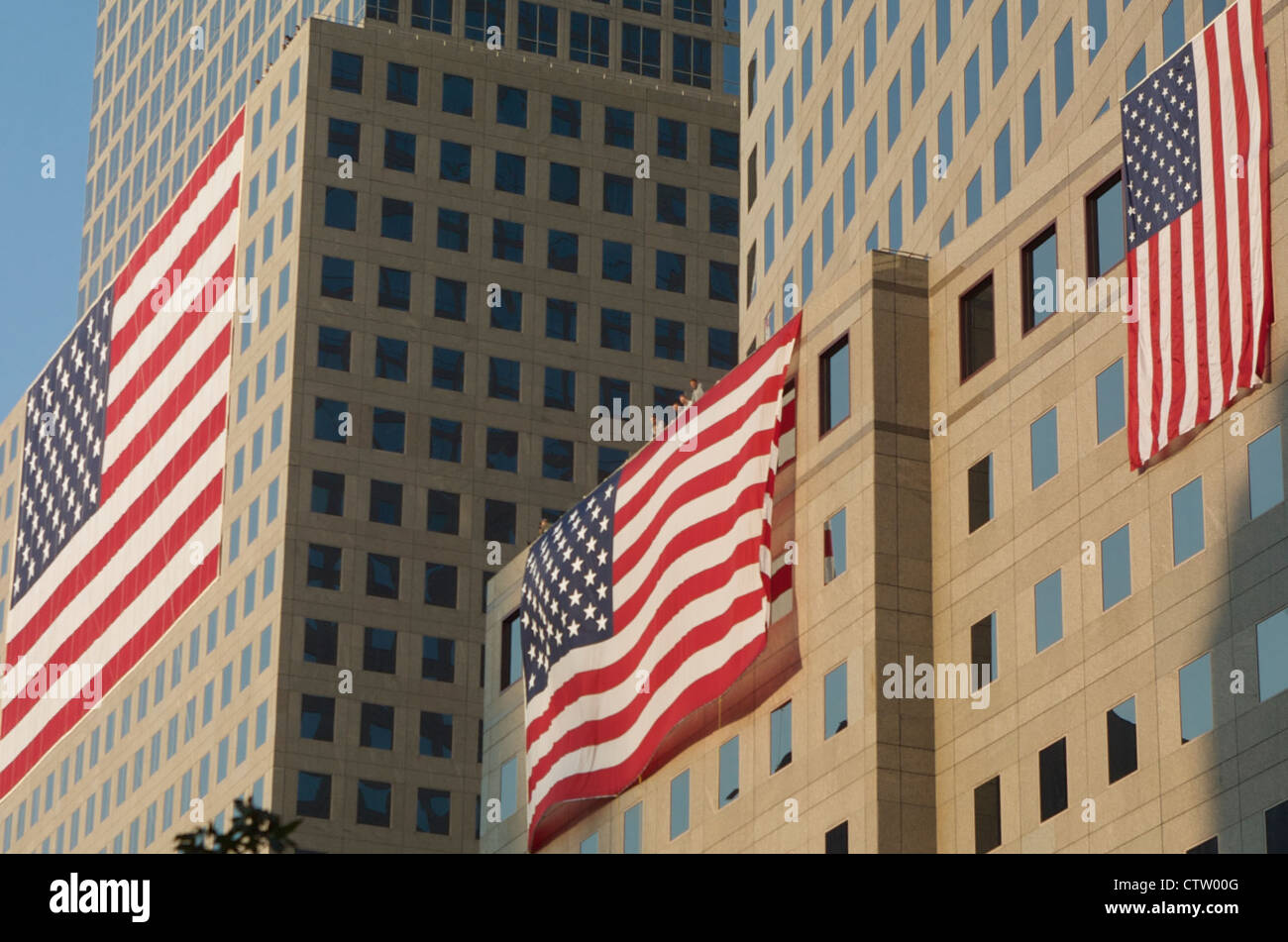 American Flags drape the side of the World Financial Center during the one year anniversary observance of the September - Stock Image