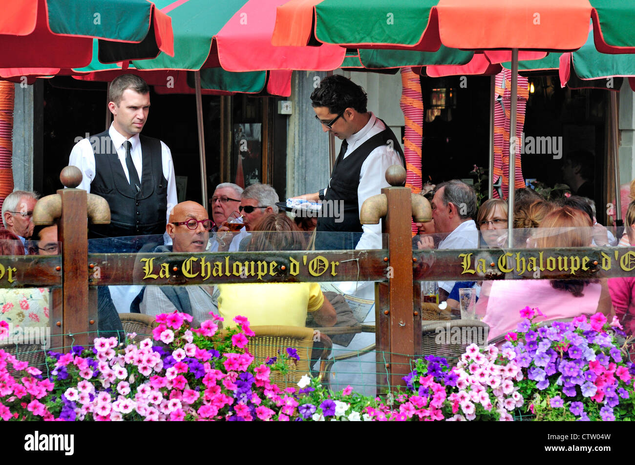 Brussels, Belgium. Waiters at café in the Grand Place - Stock Image