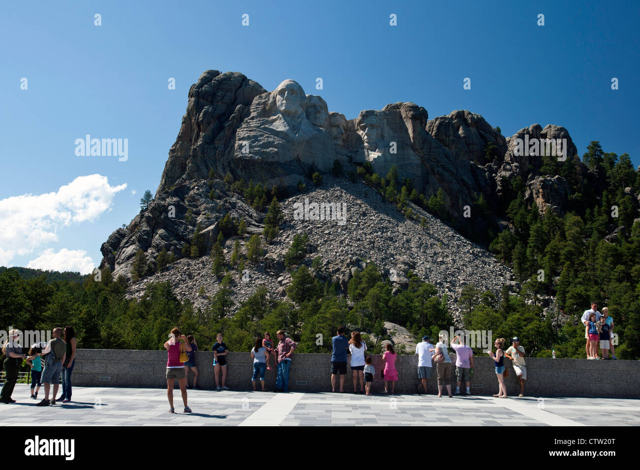 Tourists view Mt. Rushmore from the main viewing deck, Mount Rushmore National Monument, South Dakota, United States Stock Photo