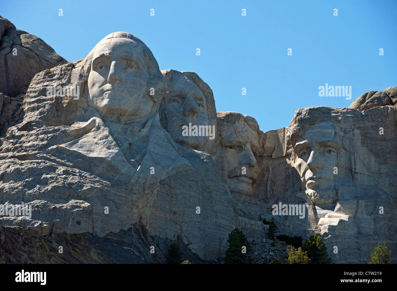 Detailed view Mt. Rushmore with sculptures of former presidents George Washington, Thomas Jefferson, Theodore Roosevelt, Stock Photo