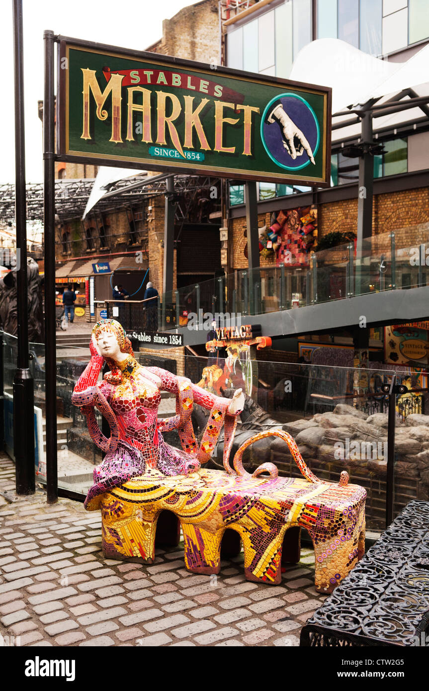 A sculpture, and bench, in the refurbished Stables Market in Camden. - Stock Image