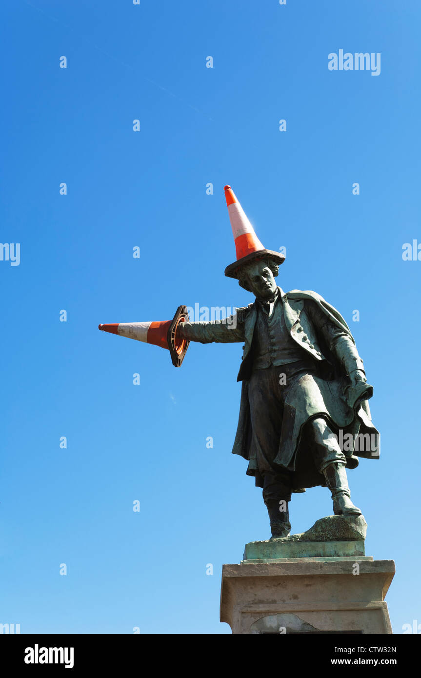 Statue of Thomas Waghorn, Pioneer and founder of the Overland Route, that have been vandalised with traffic cones. - Stock Image