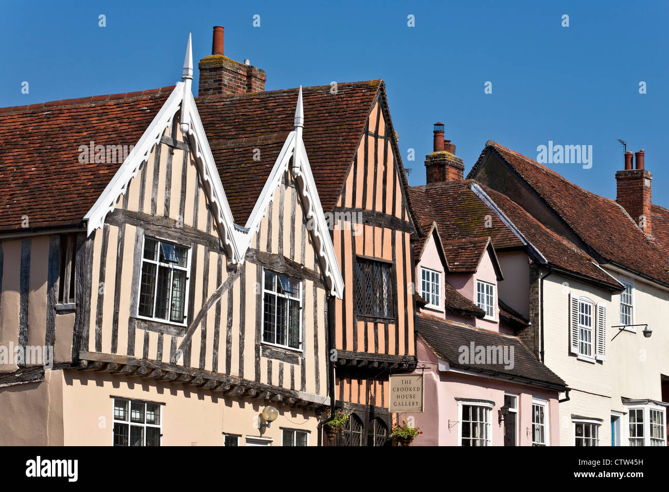 Long View of Row of Mediieval Buildings including Timber Framed Cottages in Lavenham - Stock Image