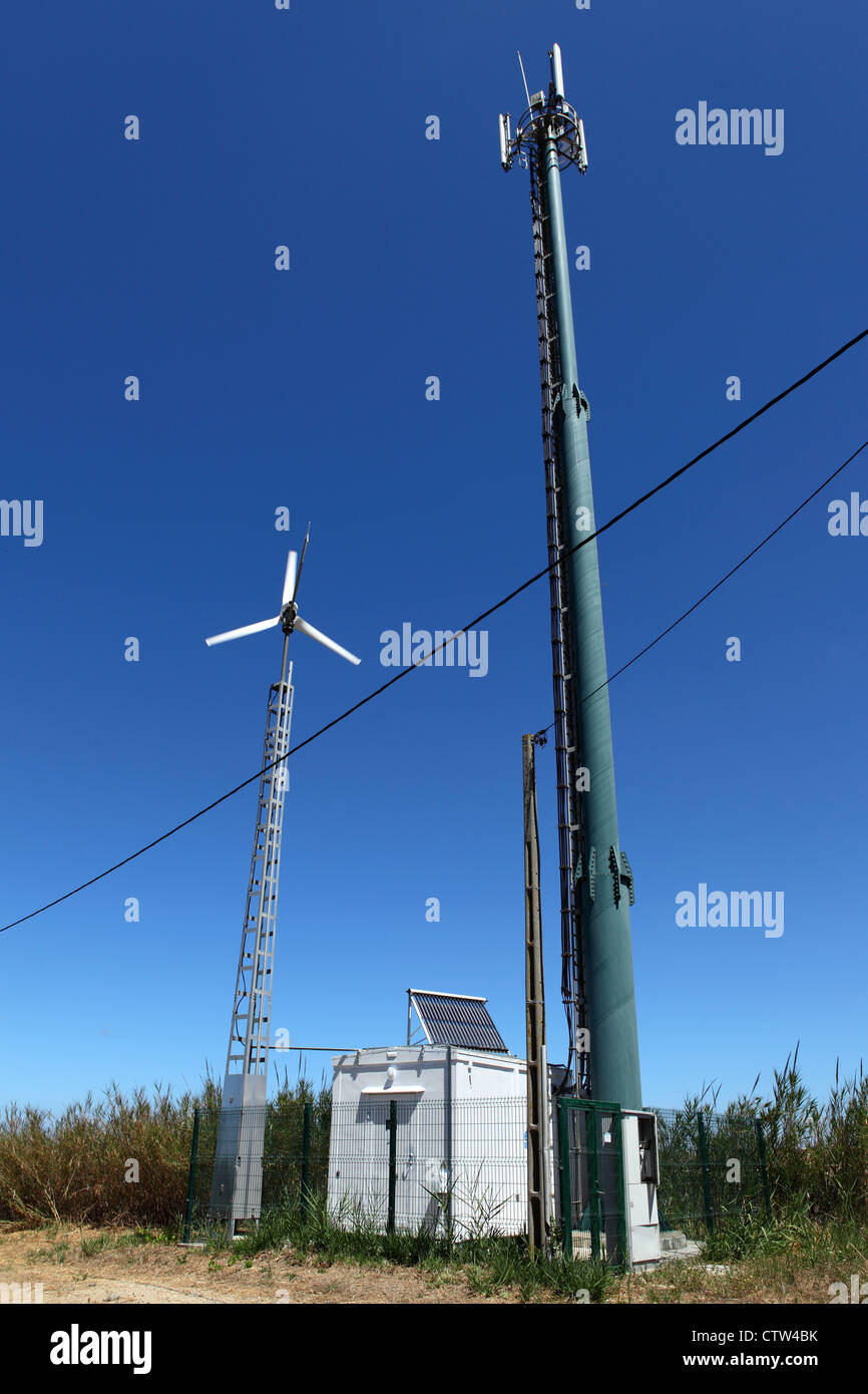 A solar and wind powered mobile telephone mast close to Lisbon, Portugal. - Stock Image