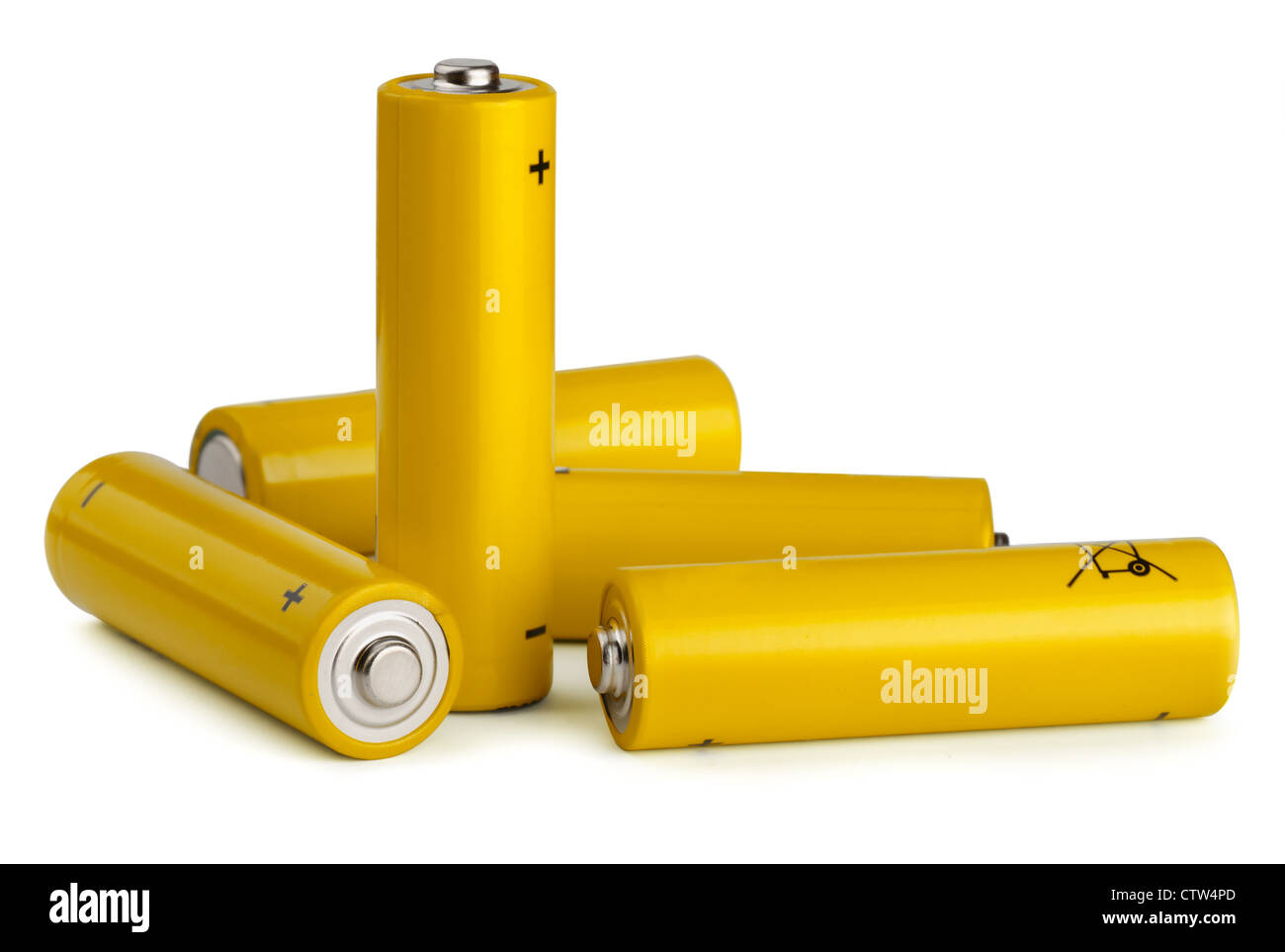 Group of yellow AA size batteries isolated on white - Stock Image