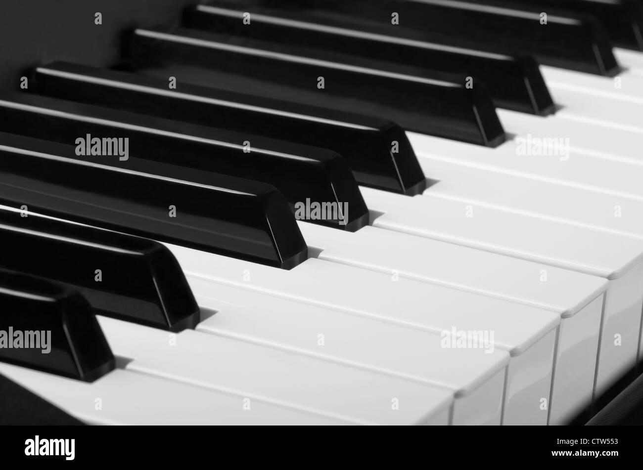 White and black keys. Close up of piano keyboard - Stock Image