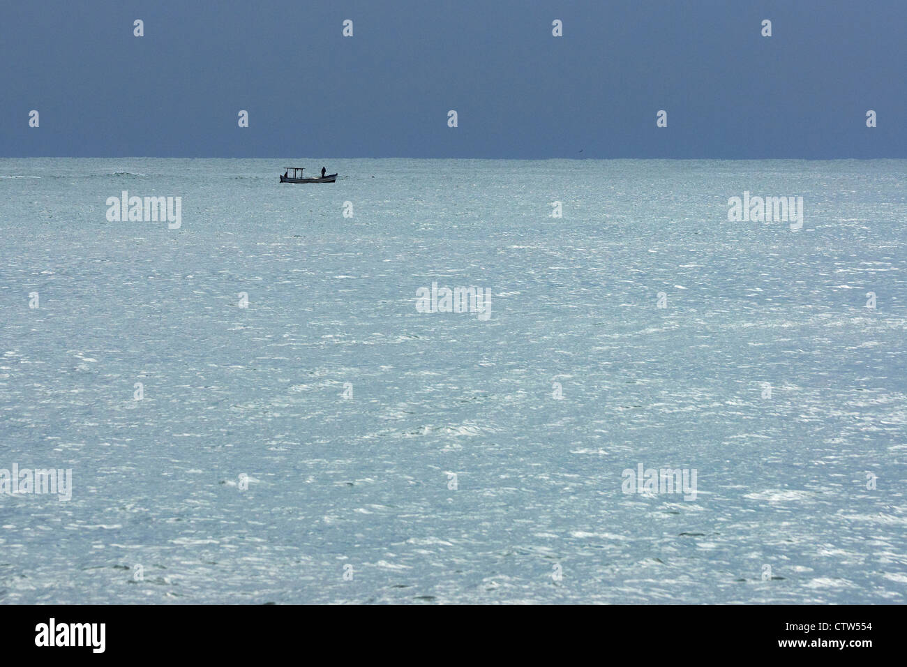 Small fisher boat on the sea - Stock Image