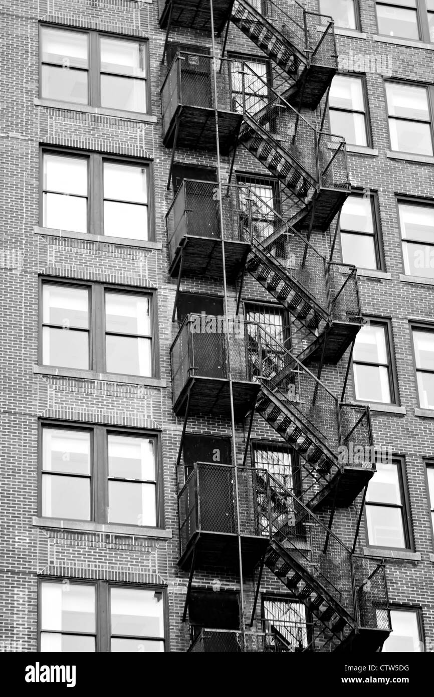 Marvelous Exterior Fire Escape Stairs On The Outside Of An Old Brick Building In  Black And White.