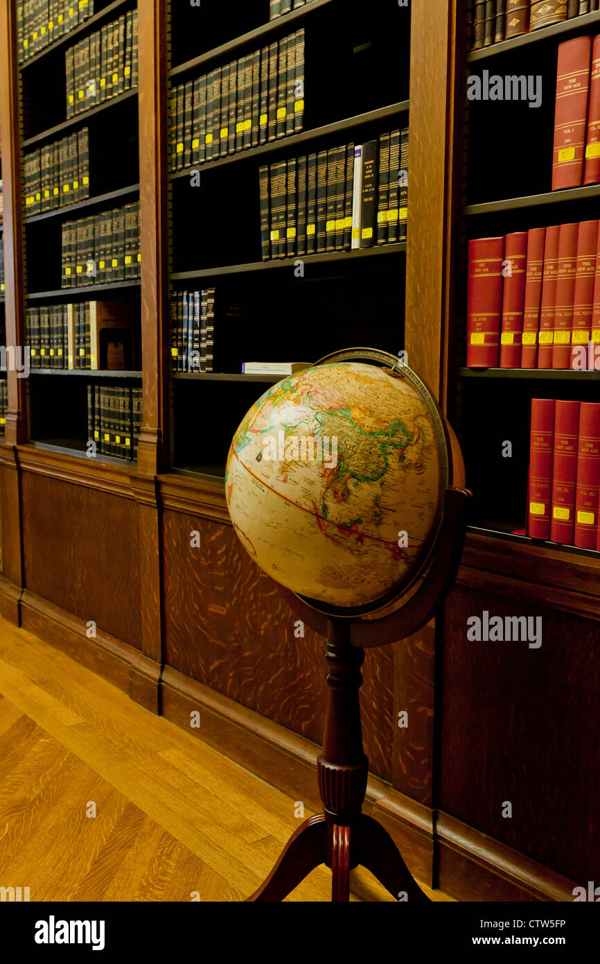 World globe in a library - Stock Image