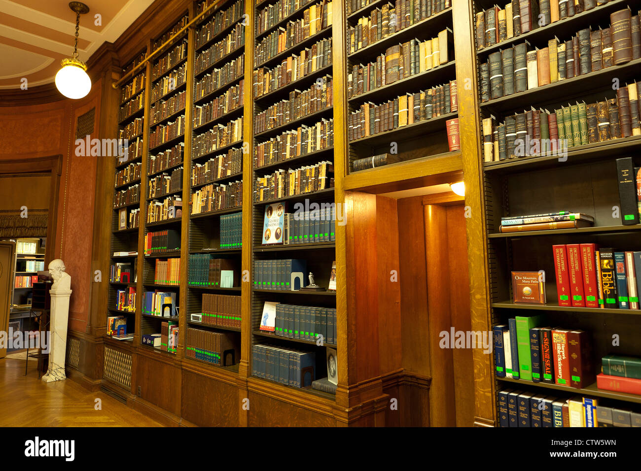 Old books on shelves in a vintage library  - USA - Stock Image