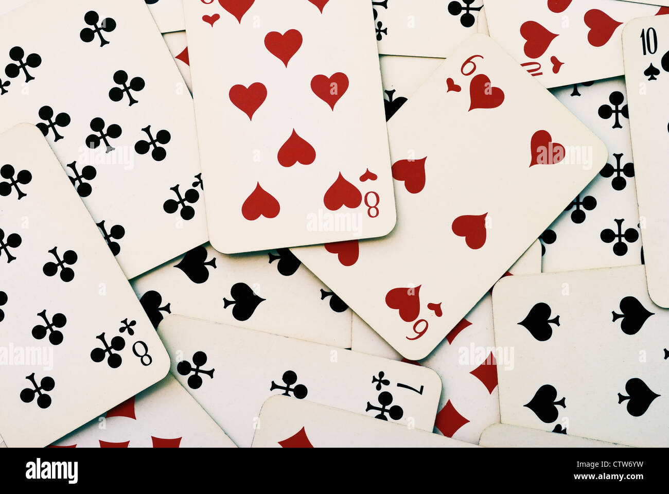 Lot of dusty old playing cards - Stock Image