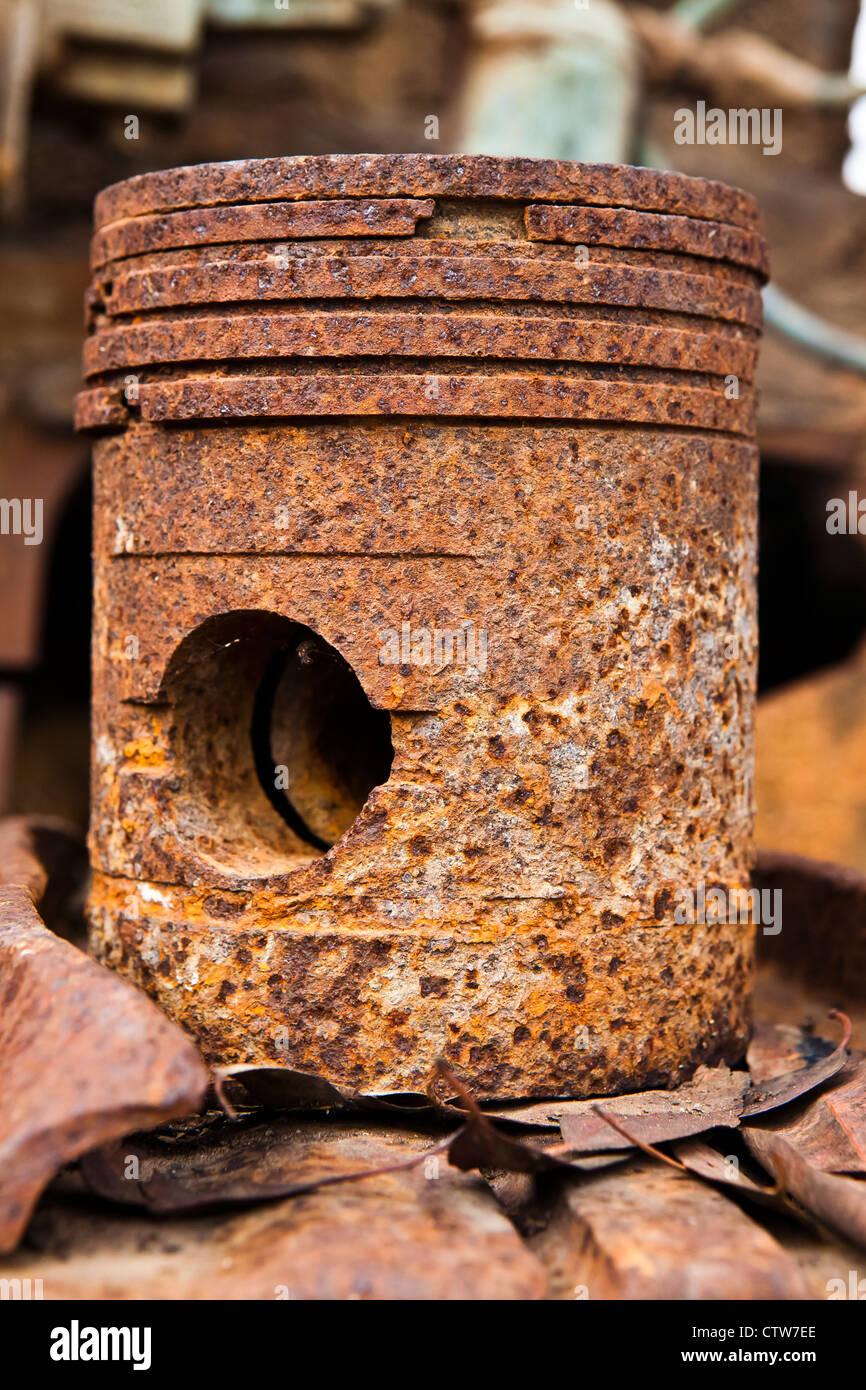 rusted piston of antique gasoline engine - Stock Image
